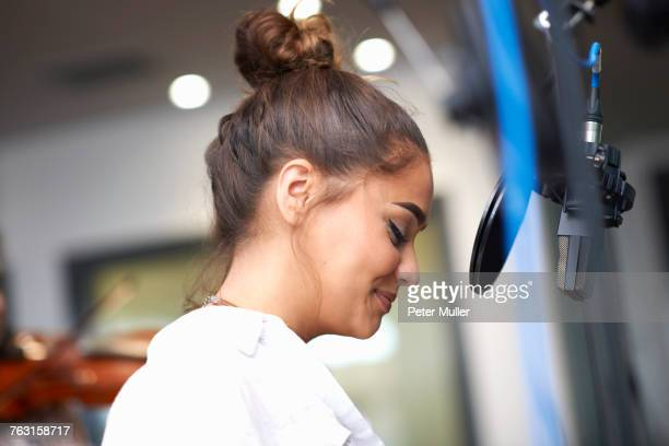 young female college student preparing to sing in recording studio - recording studio stock pictures, royalty-free photos & images