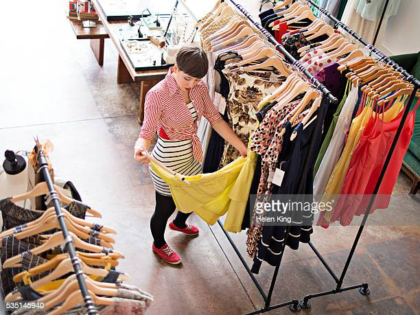 young female customer shopping for dress - archival stock pictures, royalty-free photos & images