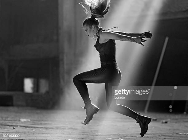 Young female dancer in an abandoned warehouse