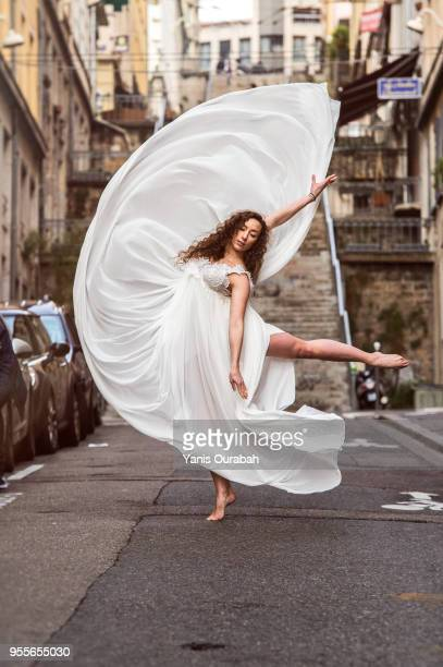 young female dancer in the streets of lyon, france - veil stock pictures, royalty-free photos & images