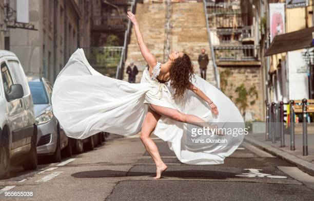 young female dancer in the streets of lyon, france - modern dancing stock pictures, royalty-free photos & images