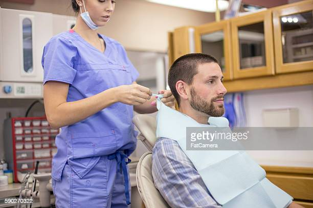 young female dental assistant prepping for a cleaning procedure - molar stock pictures, royalty-free photos & images