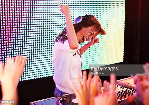 young female dj at record decks in nightclub - deck stock pictures, royalty-free photos & images
