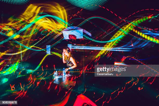 young female dj performing, light painting - electronic music stock pictures, royalty-free photos & images