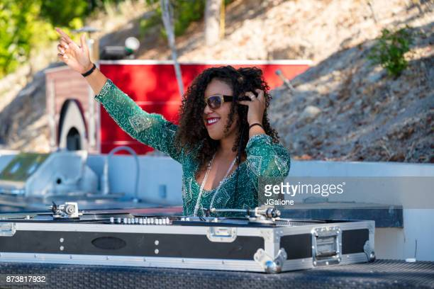 young female dj playing outdoors - club dj stock pictures, royalty-free photos & images