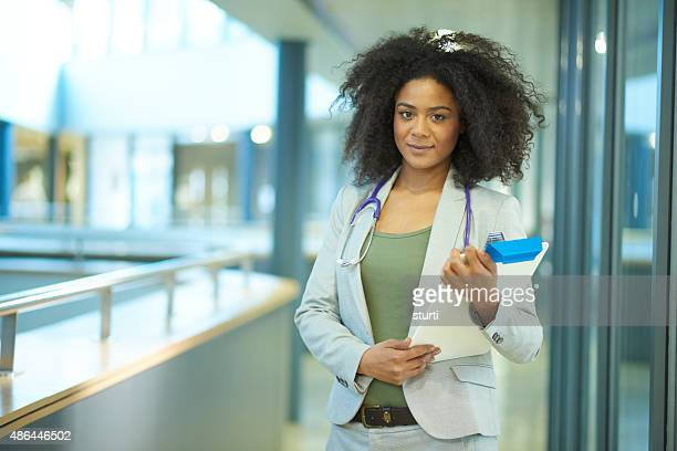young female doctor - nhs staff stock pictures, royalty-free photos & images