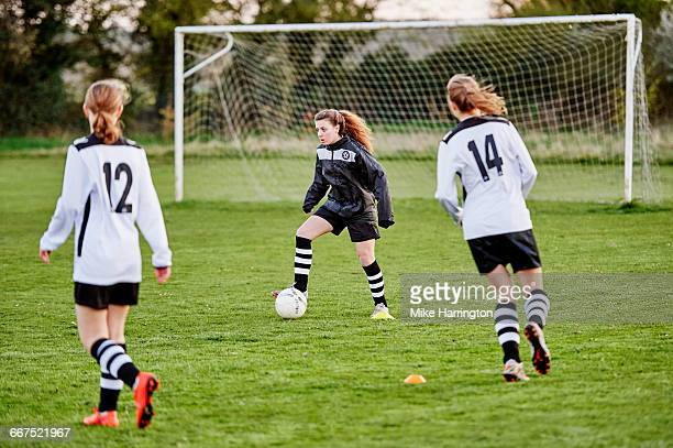 young female dribbling football - sporting term stock pictures, royalty-free photos & images
