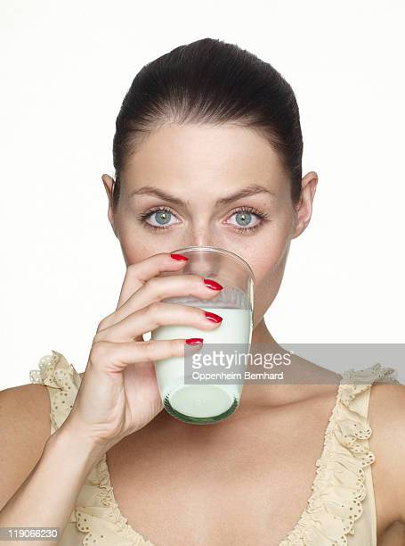 young female drinking glass of milk