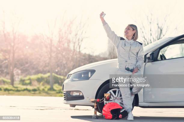young female driver - race car driver stock pictures, royalty-free photos & images