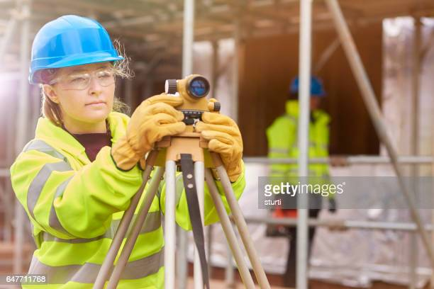 young female engineer apprentice - surveyor stock photos and pictures