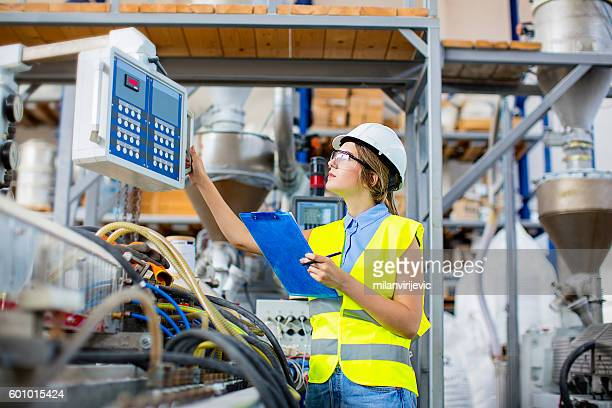 Young female engineer controlling the production