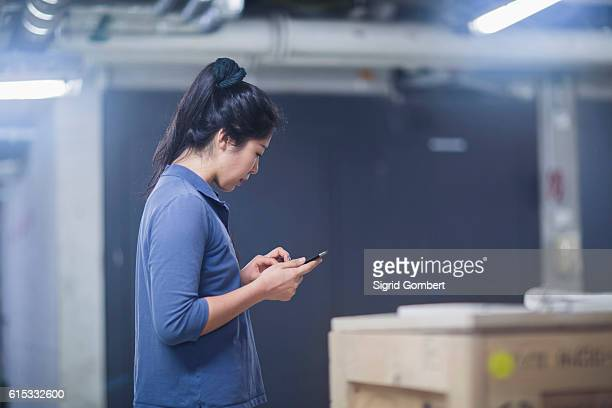 young female engineer using a digital tablet in an industrial plant, freiburg im breisgau, baden-württemberg, germany - sigrid gombert stock pictures, royalty-free photos & images