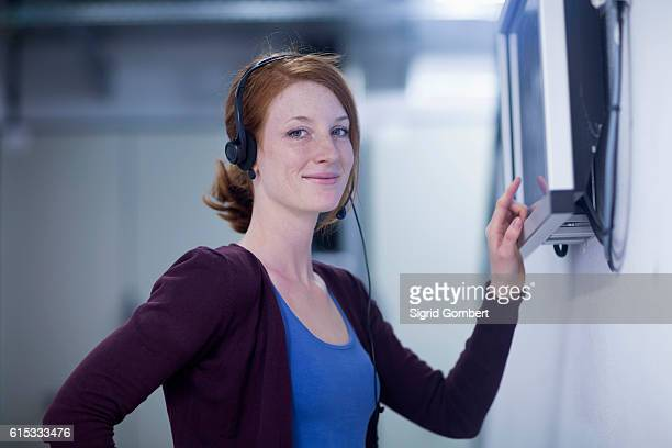 young female engineer wearing headset and working on touchscreen computer monitor in an industrial plant, freiburg im breisgau, baden-württemberg, germany - sigrid gombert stock pictures, royalty-free photos & images