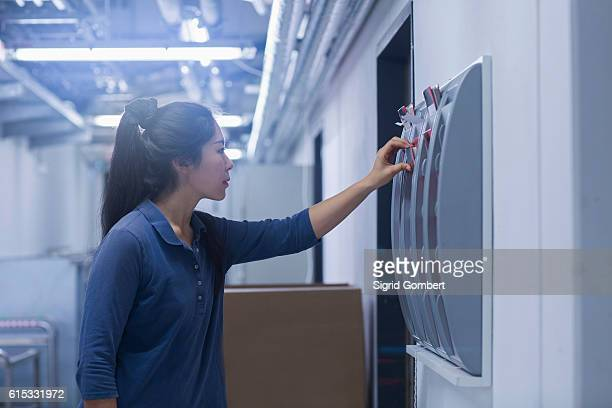 young female engineer working in an industrial plant, freiburg im breisgau, baden-württemberg, germany - sigrid gombert stock pictures, royalty-free photos & images
