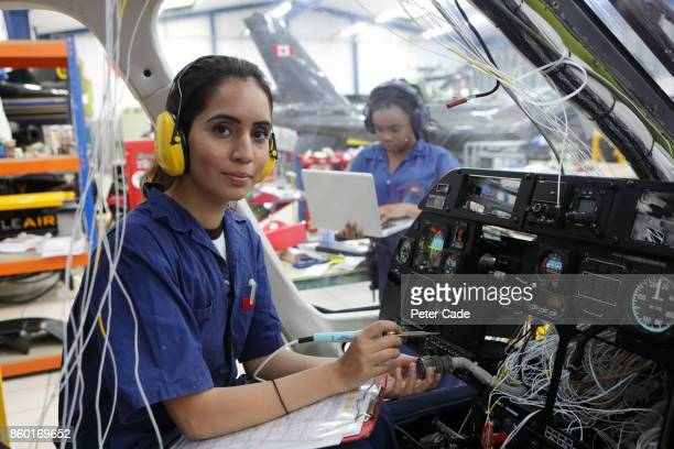 young female engineers working with helicopters - genderblend stock pictures, royalty-free photos & images