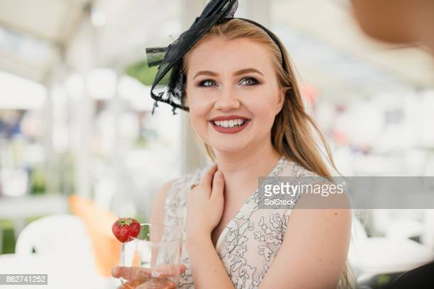 young female enjoying a glass of wine - fascinator stock pictures, royalty-free photos & images