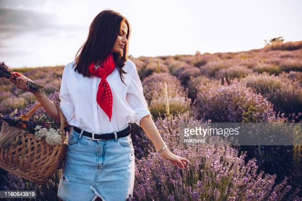Young Female enjoying summer day in lavender fields