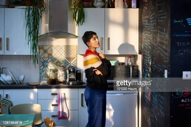 young female entrepreneur looking at notes on office blackboard - top garment stock pictures, royalty-free photos & images