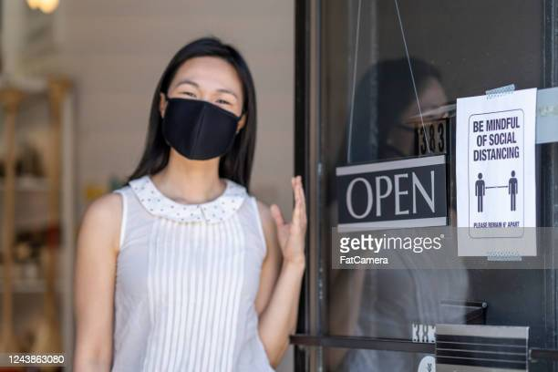 young female entrepreneur reopening her small business after covid19 - commercial activity stock pictures, royalty-free photos & images