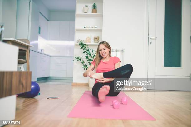 young female exercise yoga at home - aleksandar georgiev stock photos and pictures
