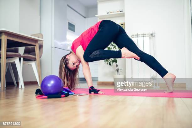 young female exercise yoga pilates at home - aleksandar georgiev stock photos and pictures