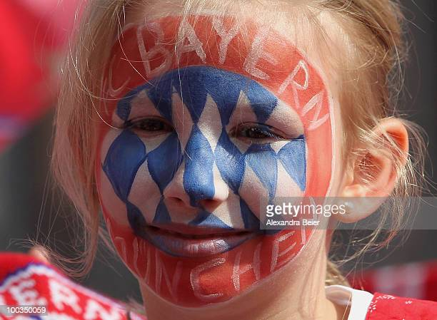 A young female fan of Bayern Muenchen celebrates the two titles at the balcony of the town hall on May 23 2010 in Munich Germany Bayern Muenchen lost...