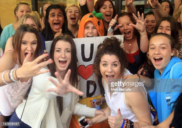 Young female fans are seen qeueing at the One Direction promotional store opening on Pitt Street on April 7 2012 in Sydney Australia The store is the...