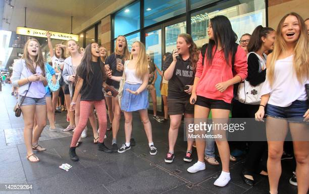 Young female fans sing and dance whilst qeueing at the One Direction promotional store opening on Pitt Street on April 7 2012 in Sydney Australia The...