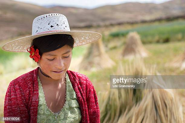 Young female farmer in the Andes of Bolivia on April 15 2016 in Sacaca Bolivia