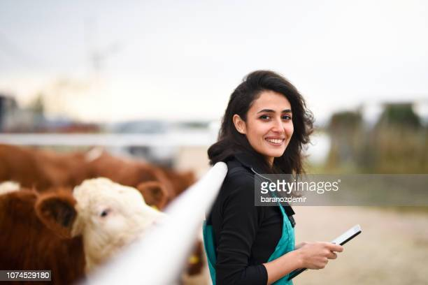 young female farmer using a digital tablet - north america stock pictures, royalty-free photos & images