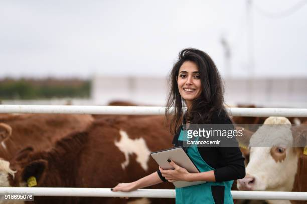 Young female farmer using a digital tablet