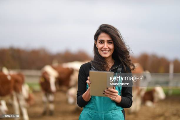 young female farmer using a digital tablet - young animal stock pictures, royalty-free photos & images