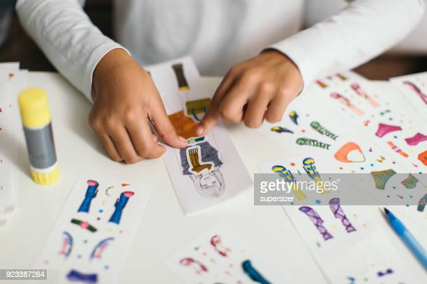Young female fashion designer at work