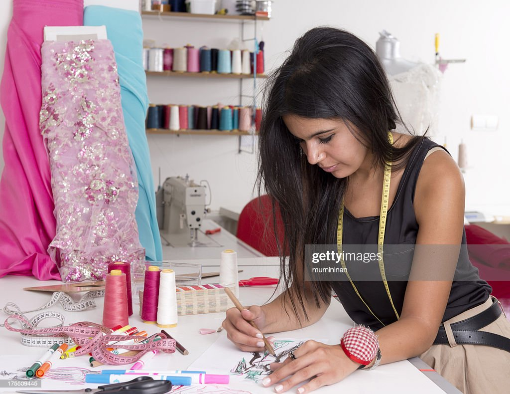 Young Female Fashion Designer Working On Her Next Design ...