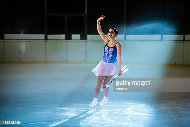 young female figure skater performing - figure skating stock pictures, royalty-free photos & images