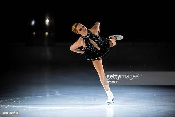 Young female figure skater performing