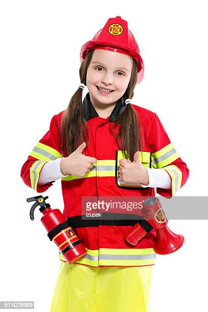 young female firefighter - firefighter's helmet stock photos and pictures