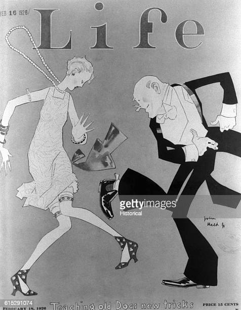 A young female flapper dances the Charleston a dance developed in the 1920s with an elderly man