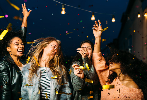 Young Female Friends Enjoying Party At Night - gettyimageskorea