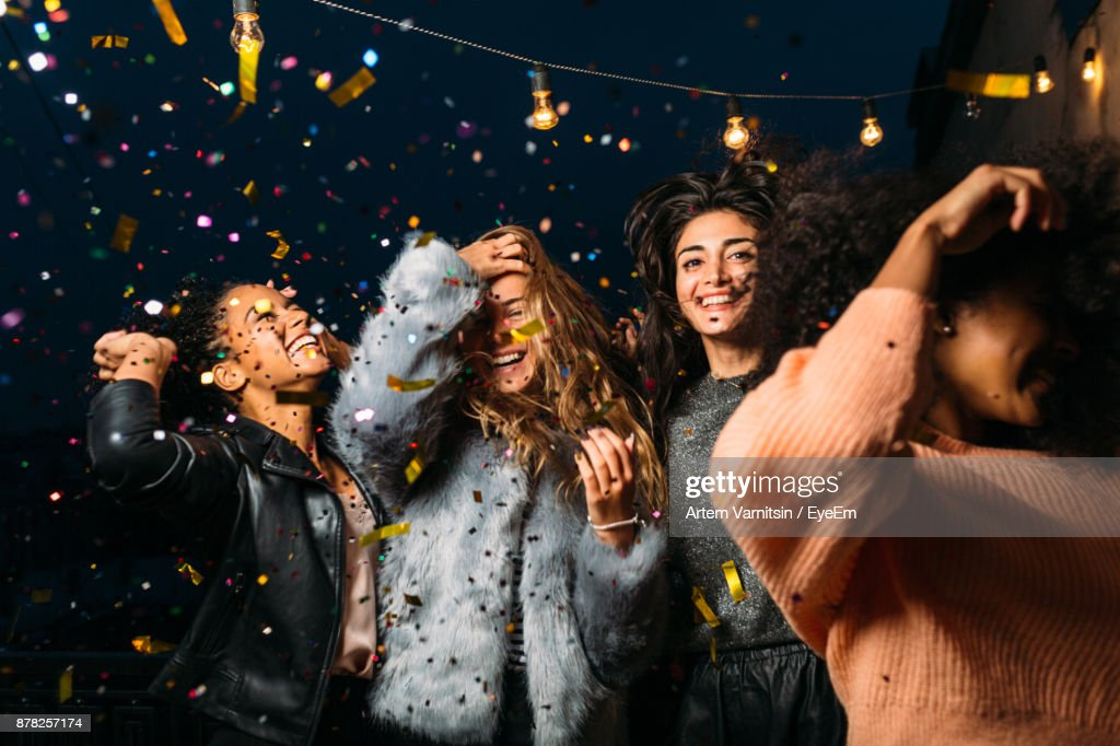 Young Female Friends Enjoying Party At Night : Stock-Foto