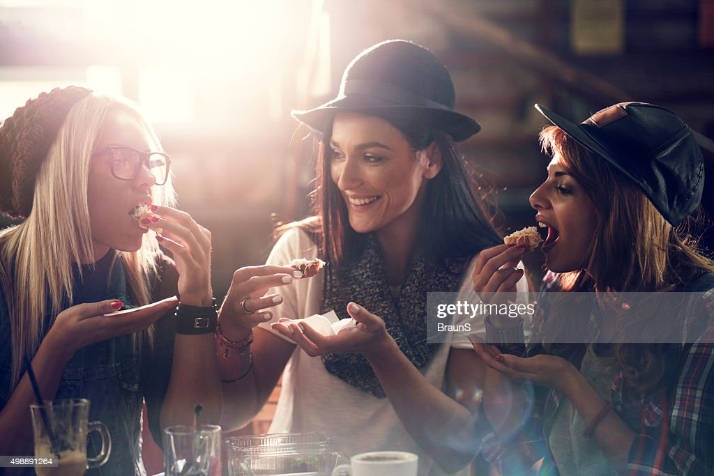 Young female friends having a snack in a cafe. : Stock Photo
