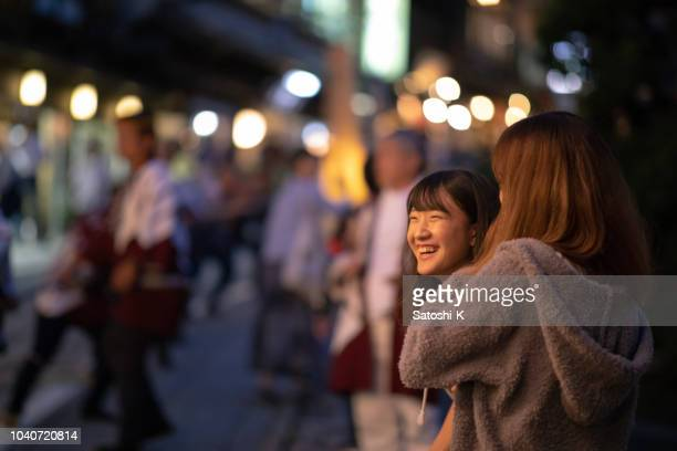 young female friends having fun with japanese autumn festival - parade stock pictures, royalty-free photos & images