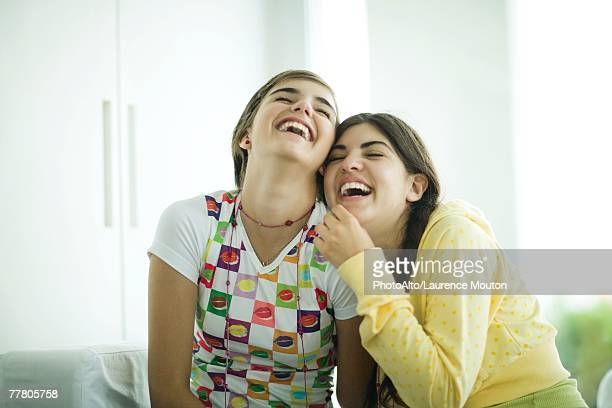 Young female friends laughing