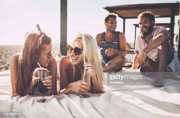 young female friends talking in summer day on a bed. - incidental people stock pictures, royalty-free photos & images