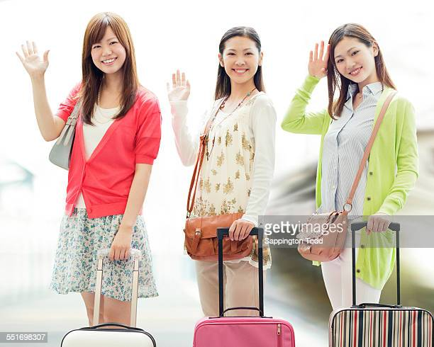 Young Female Friends With Luggage