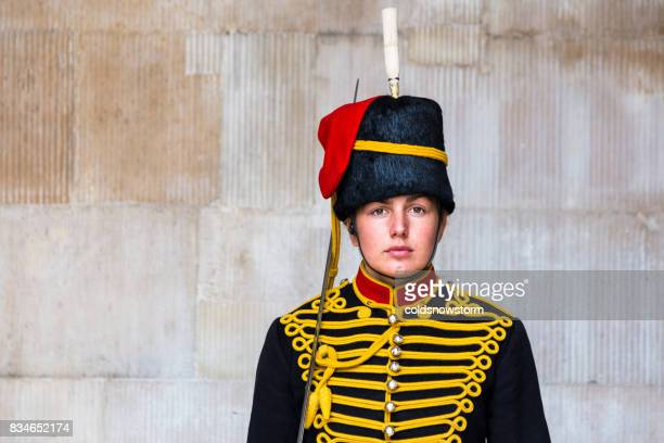 Young female guard on duty at horse guards parade, London, UK