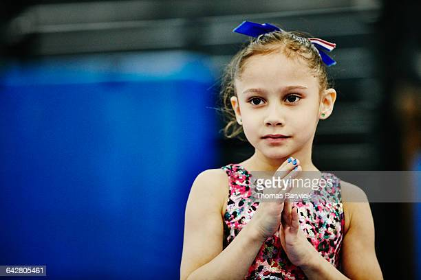 young female gymnast during training session - gymnastics poses stock pictures, royalty-free photos & images