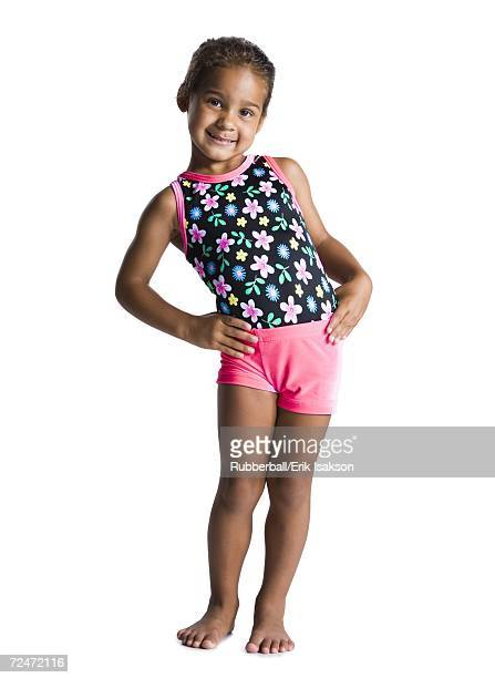 young female gymnast with hands on hips - swimwear stock pictures, royalty-free photos & images