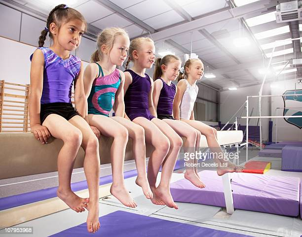 Young female gymnasts at training session