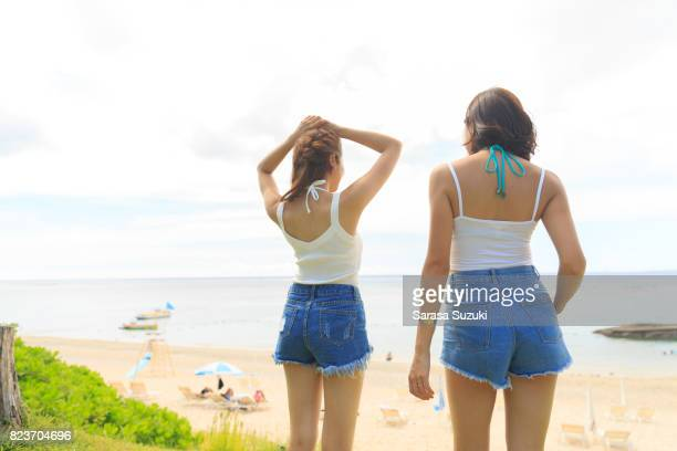 young female having fun. - denim shorts stock pictures, royalty-free photos & images